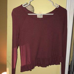 burgundy knit top.